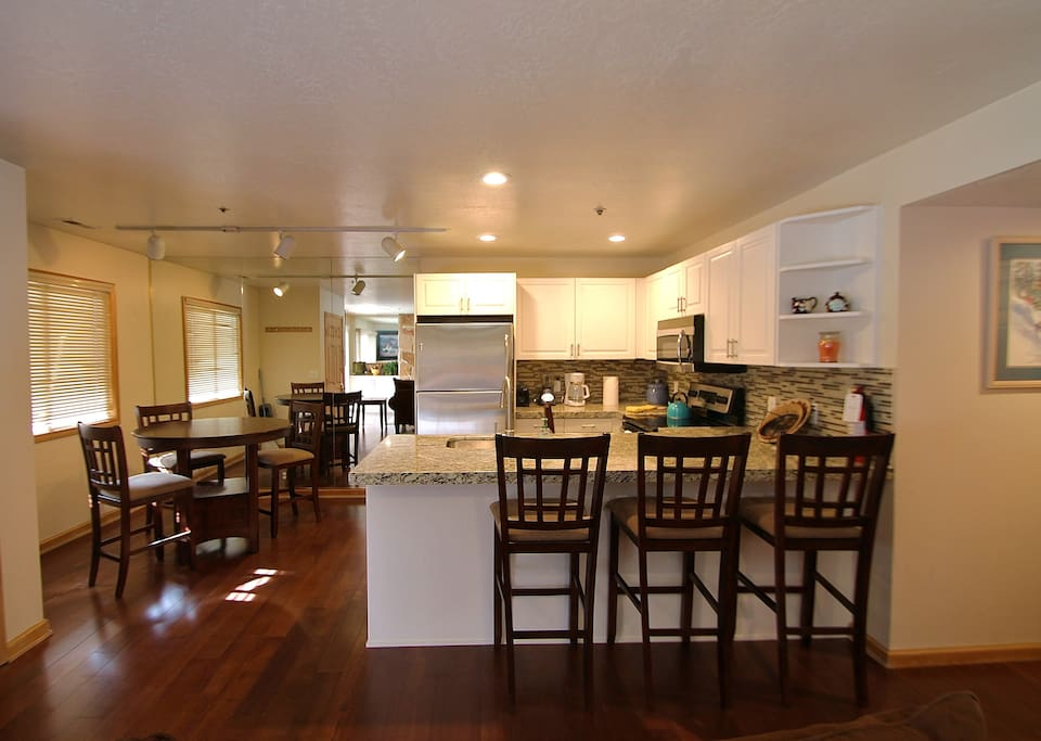 Kitchen, bar and dining area