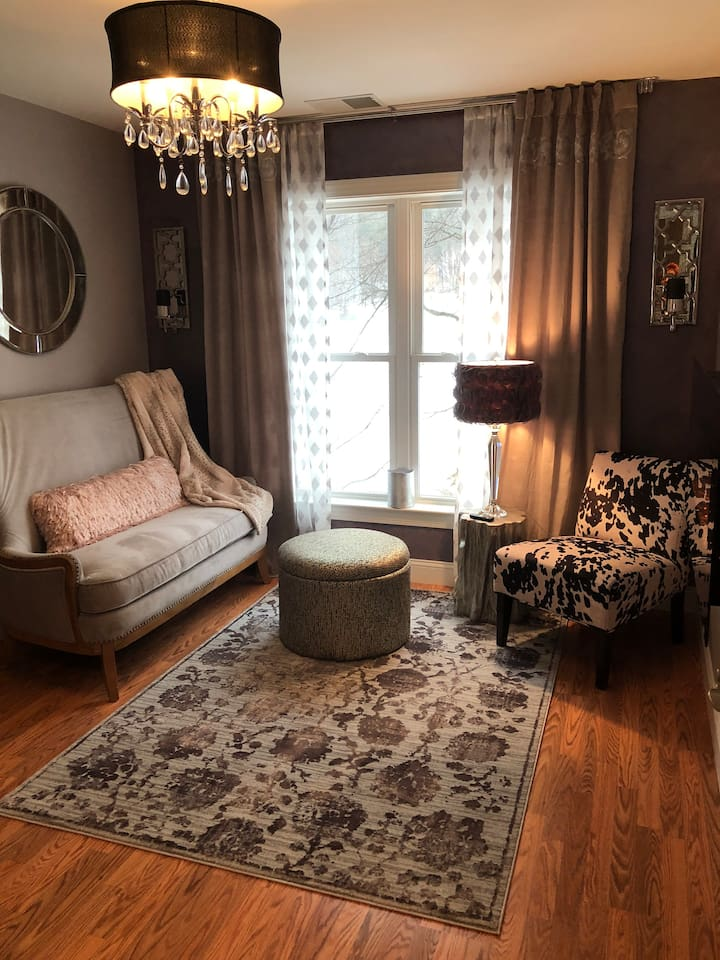Stretch out and relax in this glam 2 room suite.