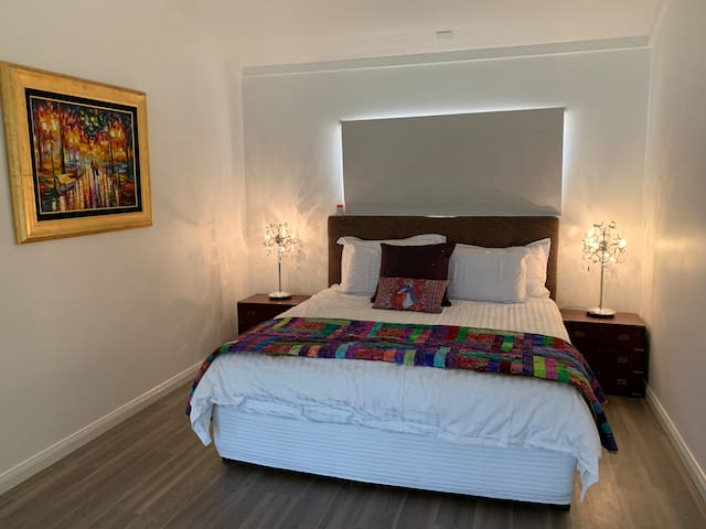 Your king size bed, identical to those found at Crown Towers, with super king pillows.