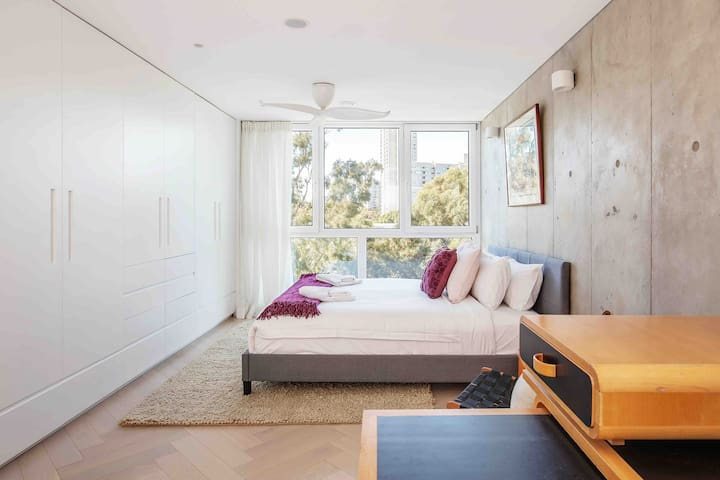 The bedroom features a king bed, ample built-in storage space, and shut-out blinds. Enjoy a good nights sleep with triple glazed windows.