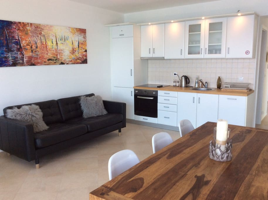This is the living/dining area. Fully functional kitchen, oven, hob, etc.