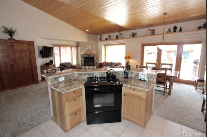 Fully equipped kitchen is open to the living and dining areas