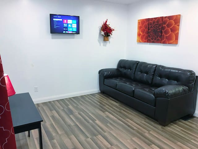 Relax in the modern living room with two sleeper sofas and a Roku TV! The WiFi reaches the whole house for your convenience!