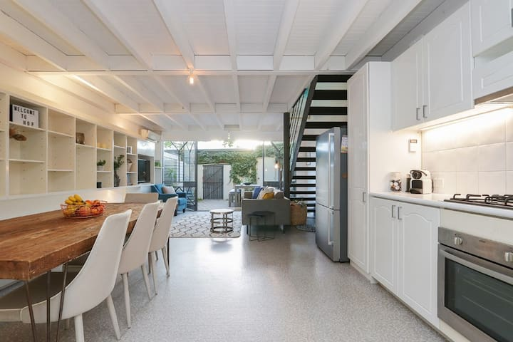 Open plan kitchen, dining and living space open to private courtyard