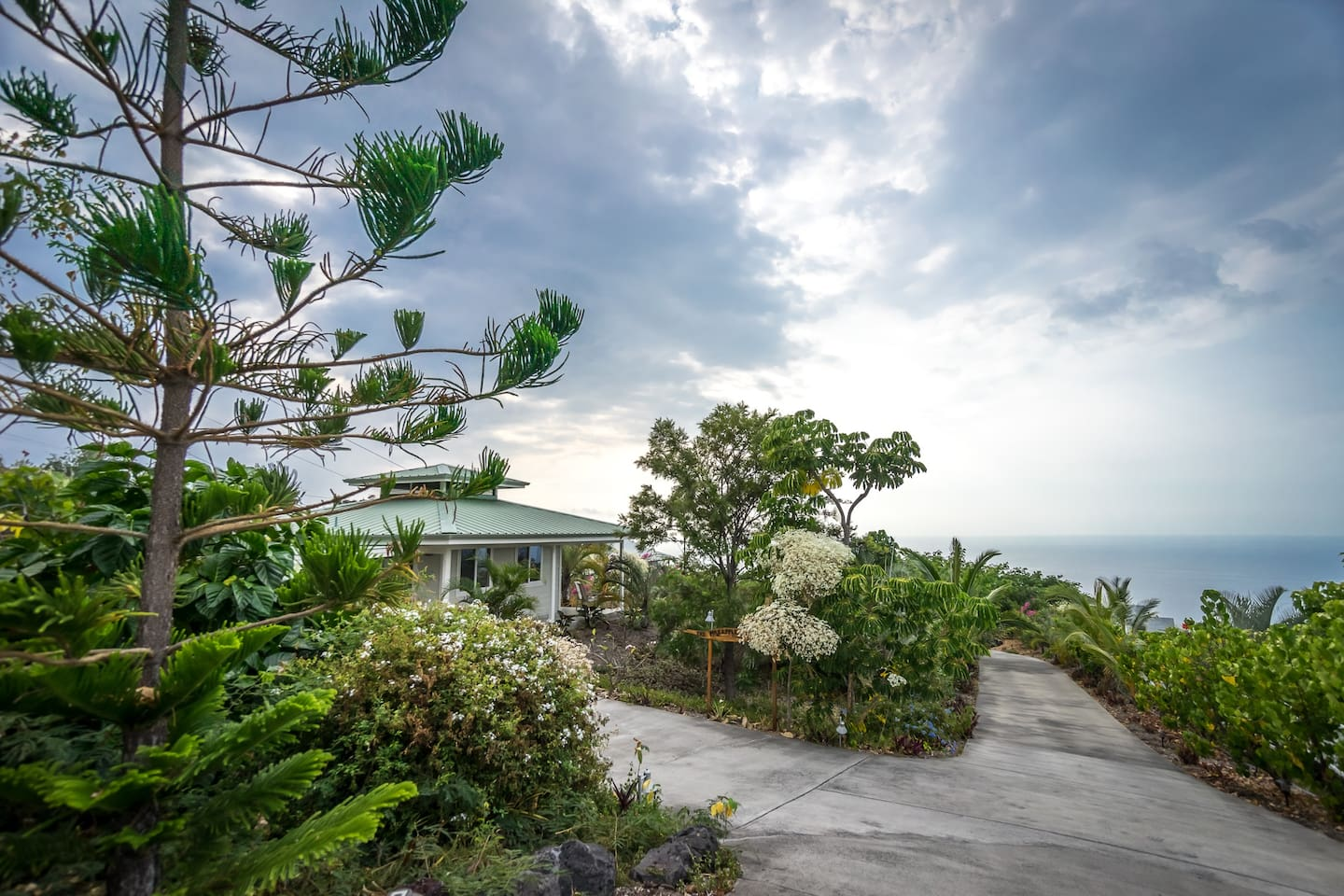 Enjoy the tropical landscape with ocean views at this stand alone comfortable home.