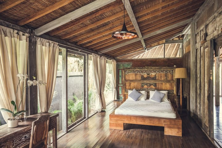 Bedroom with king size bed and bathroom.