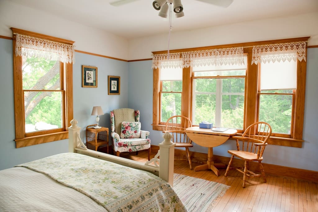 Snowbird Inn guest room with queen bed and private bath. The view is of the outbuildings, barn and gardens.
