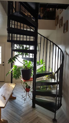 spiral stair leading to room