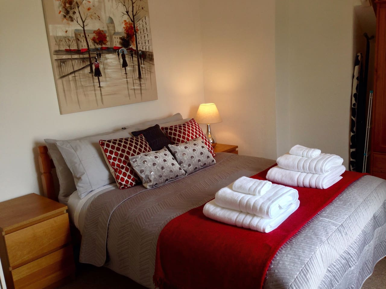 Double bed with cotton sheets and fluffy white cotton towels
