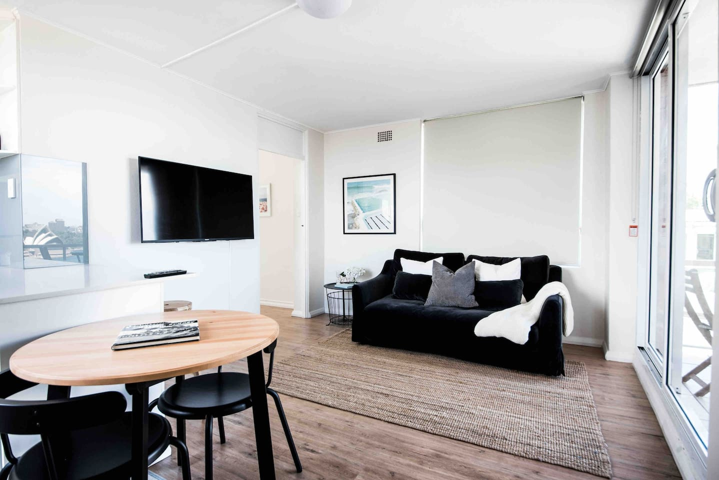 Living room with flat screen smart tv, unlimited wifi and views of Sydney Harbour