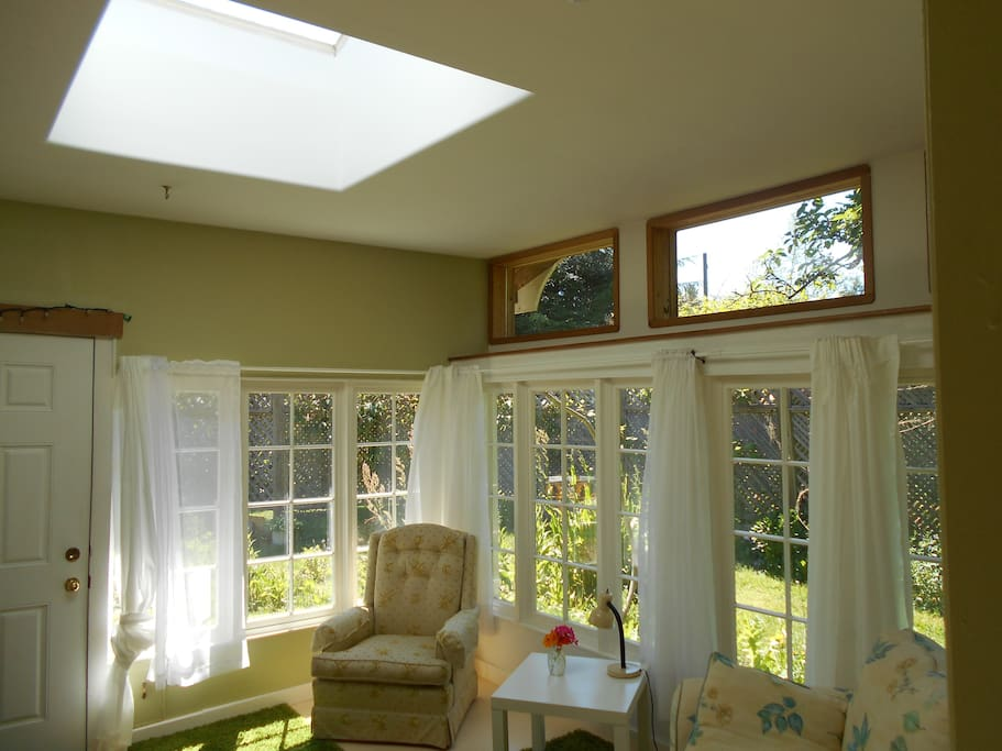 Sunroom, sitting room. Great place to bask in warm sun or watch the full moon thru the large skylite.
