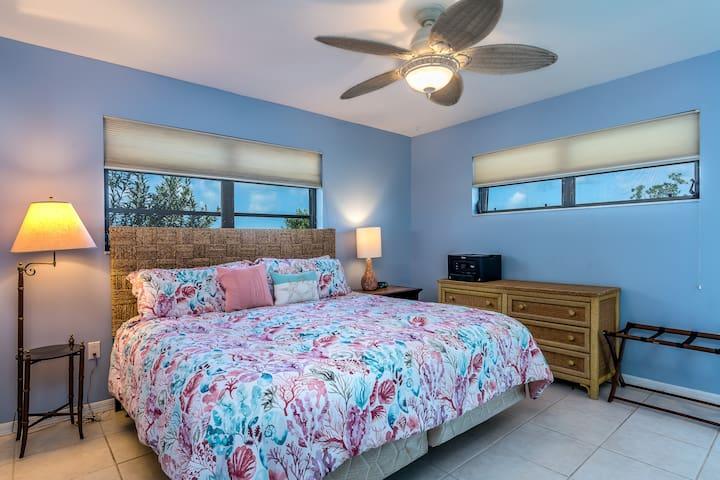 King bed in master bedroom suite.