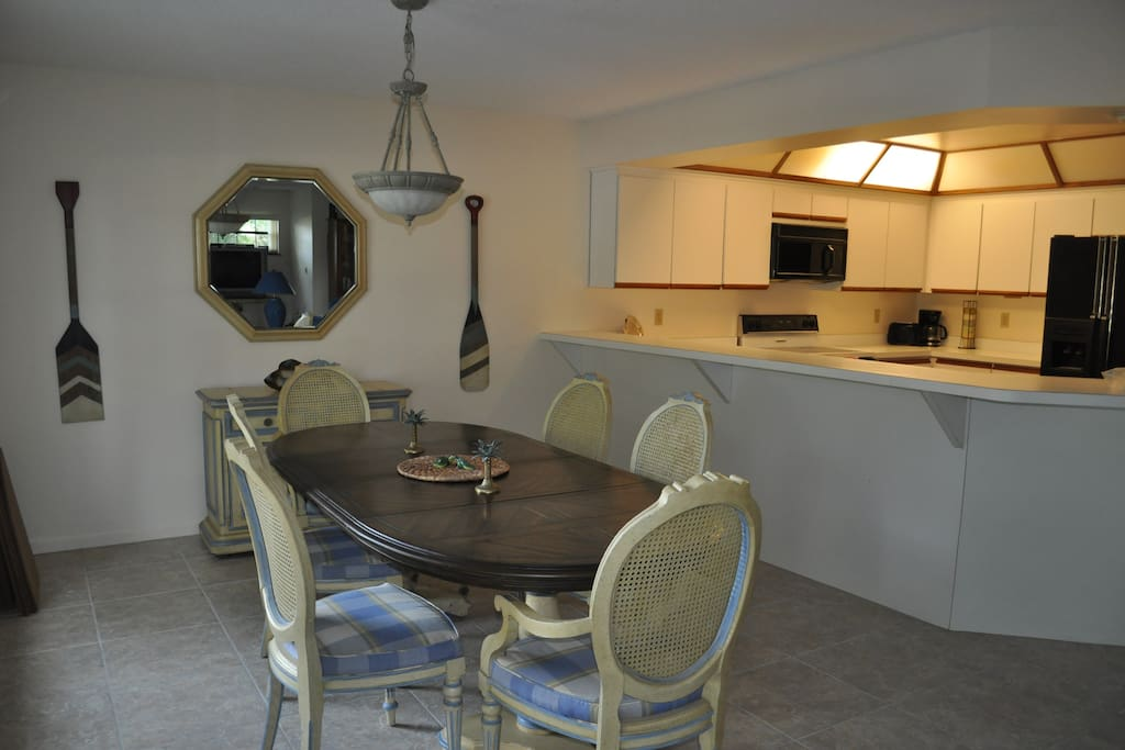 Kitchen has counter space in dining area.