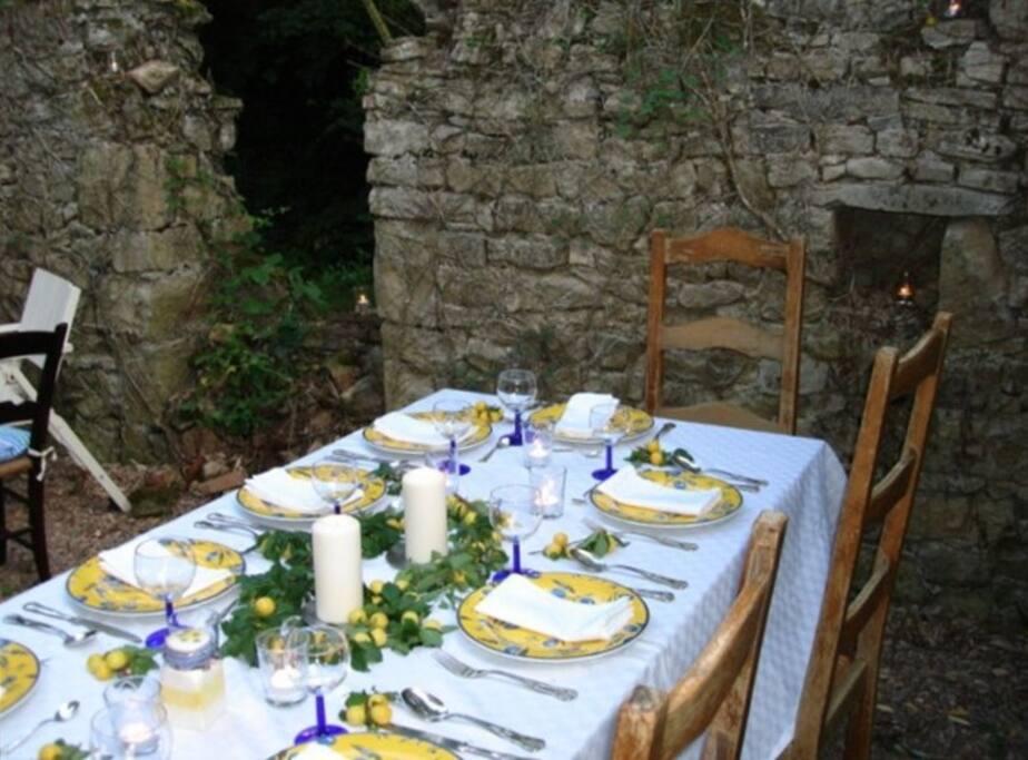 "Terrasse in back of house for dining ""al fresco""."
