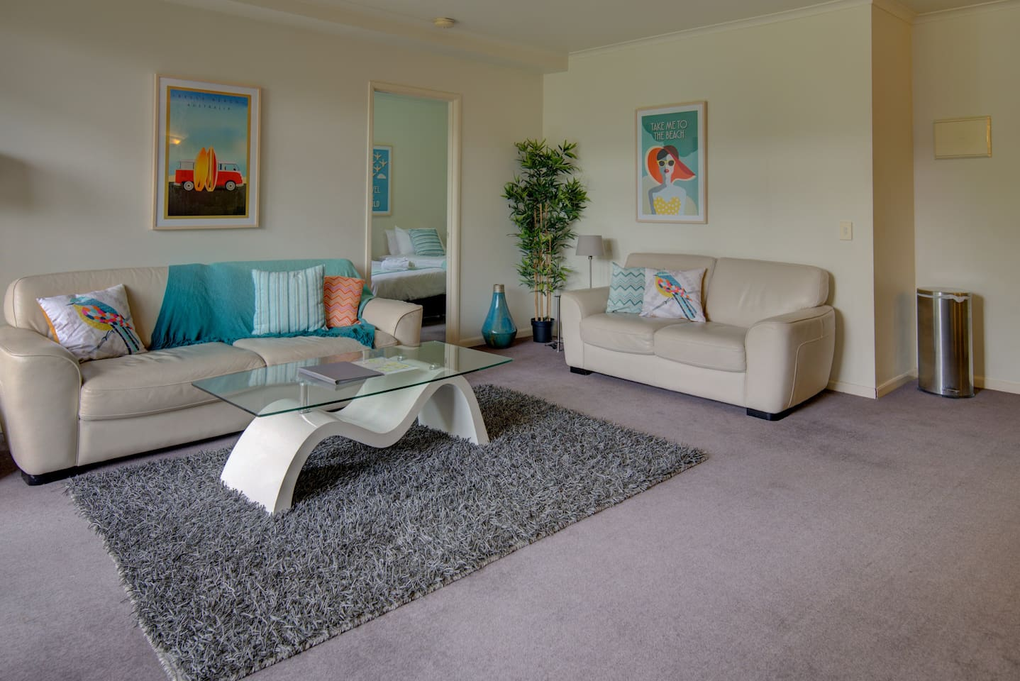 Large lounge with balcony overlooking the gardens and tennis court
