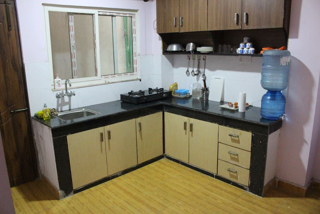 Kitchen with Kithchenwares and stoves (Tiled floored kitchen)