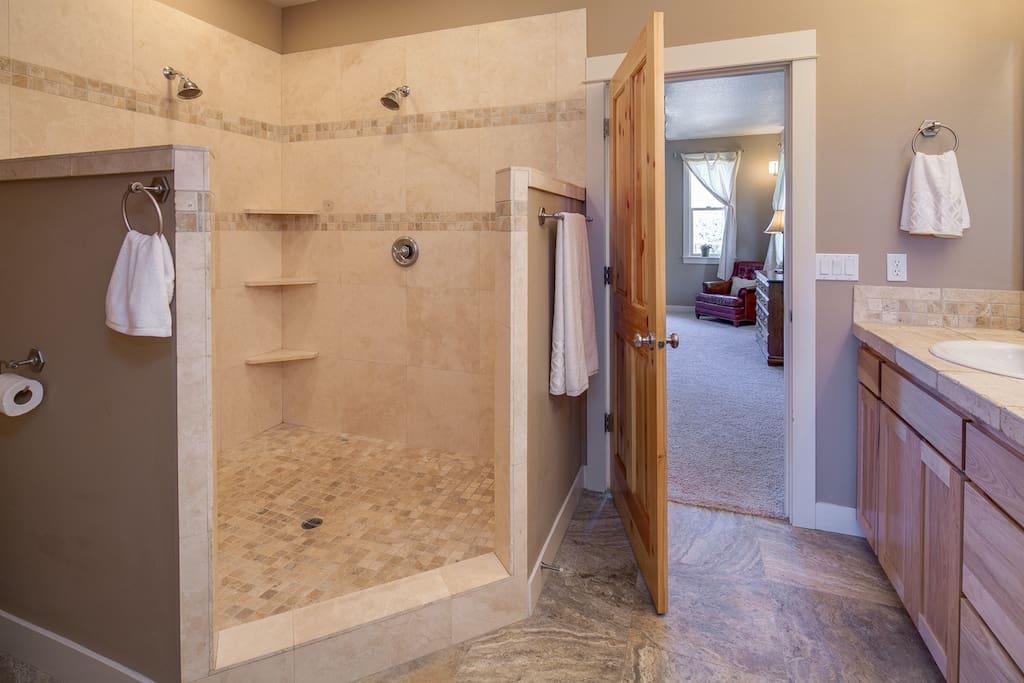 Master bath with dual-head shower.