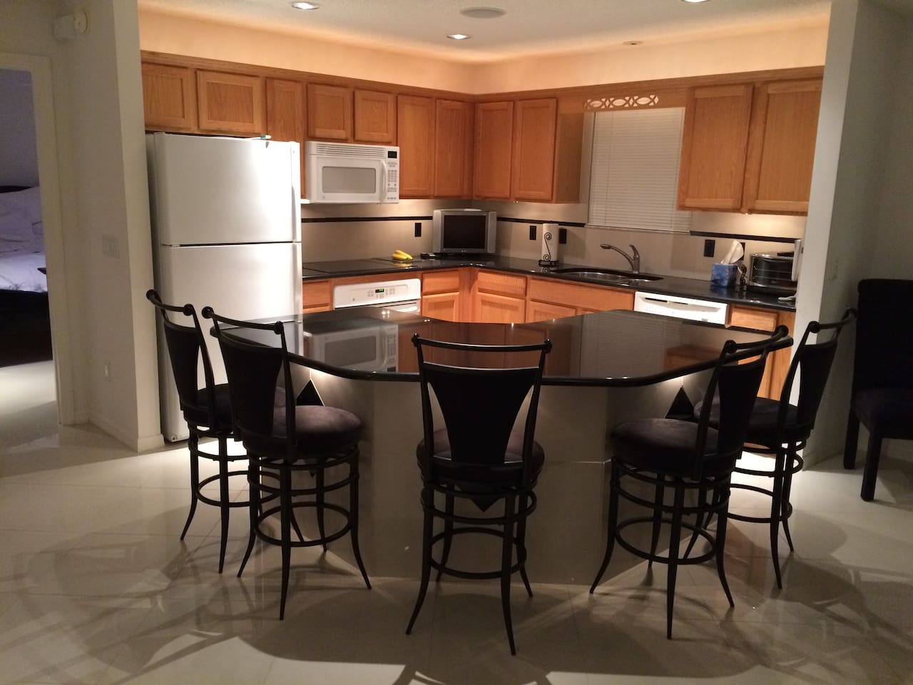 Island seating for five, Granite counter top and recessed lights overhead