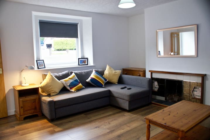 Large lounge, very comfortable settee that converts to a great double if extra sleeping space is needed.