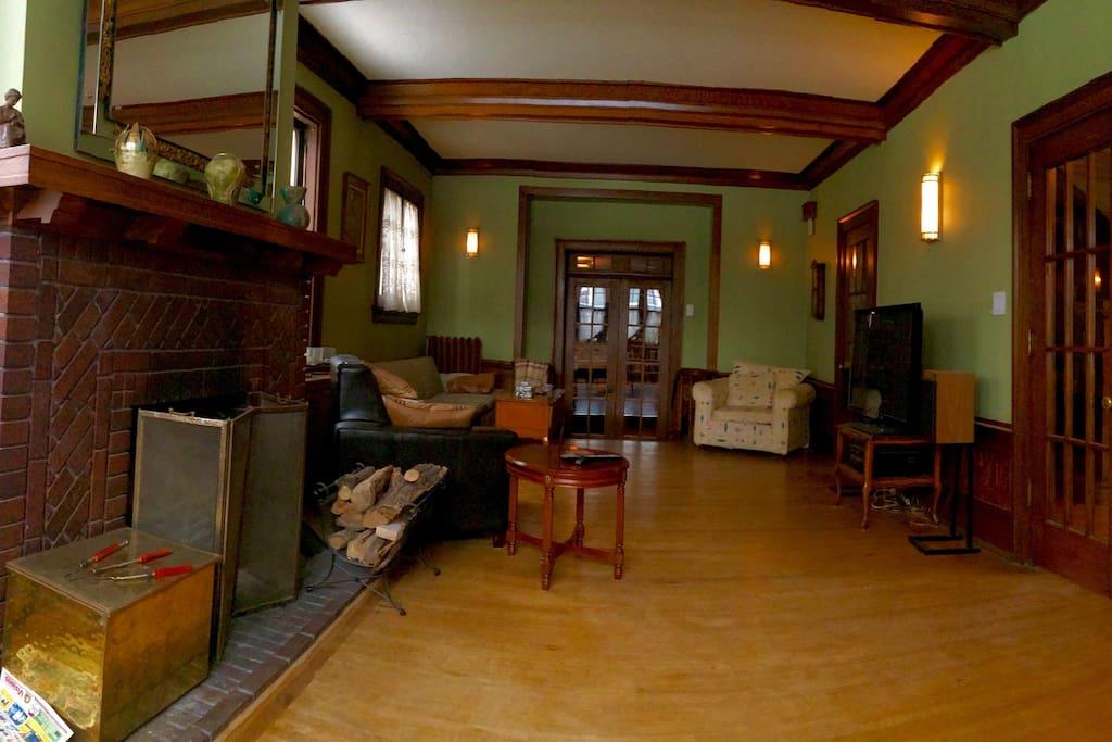 "Massive Living room with 55"" Plasma w/Sound, Wood Fireplace, plenty of seating."