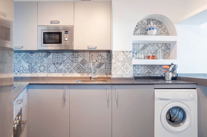 Spanish tile presents a beautiful accent in the kitchen