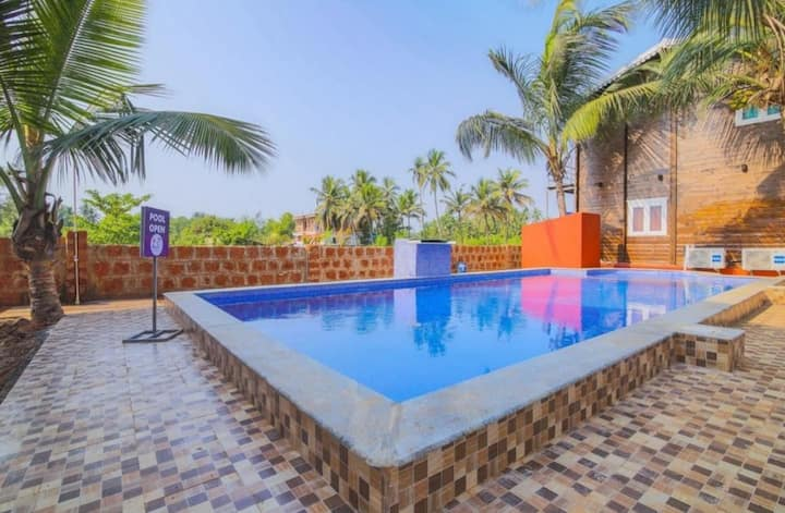 Swiss cottage room with Swimming pool at Arambol