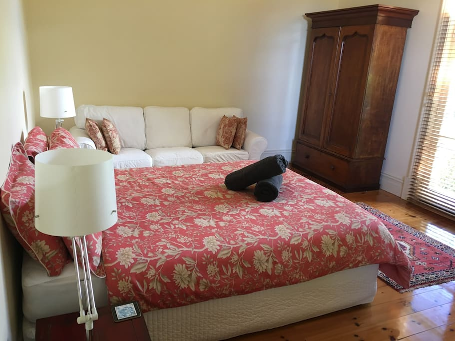 Suite 1, queen bed, 3 seater couch, antique furnishings