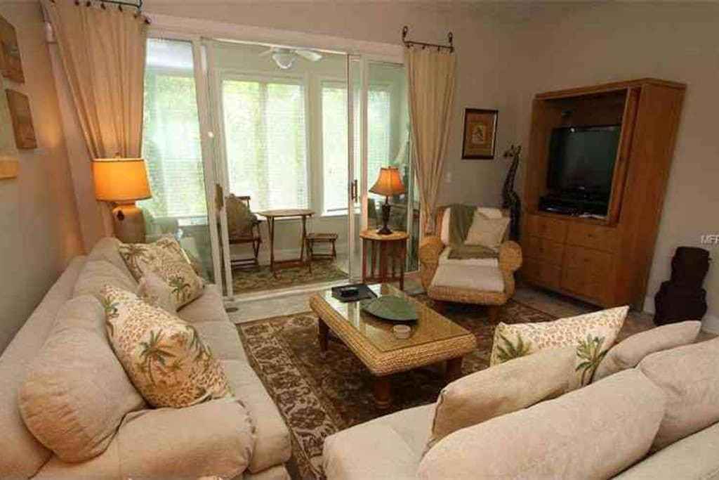 Beautifully furnished top to bottom, living room with adjacent 'treehouse' like sunroom....