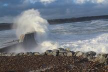 Waves crashing over Cullen Pier.