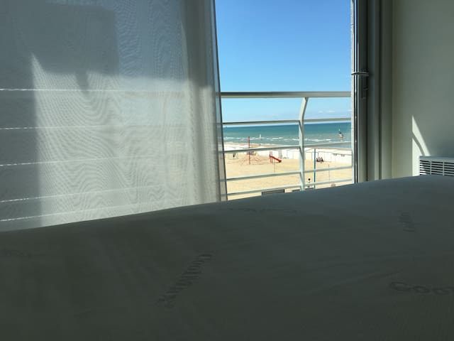 Wake up in the master bed room with sea view .