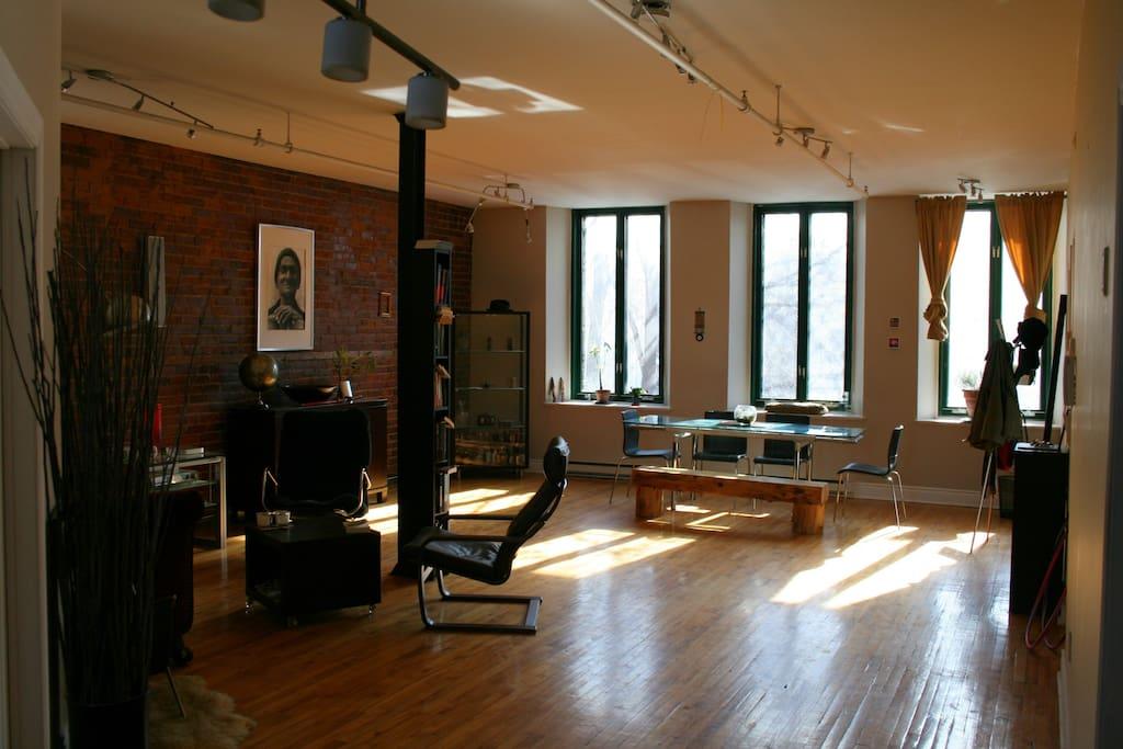 Massive open loft concept with original brick and hardwood floors.