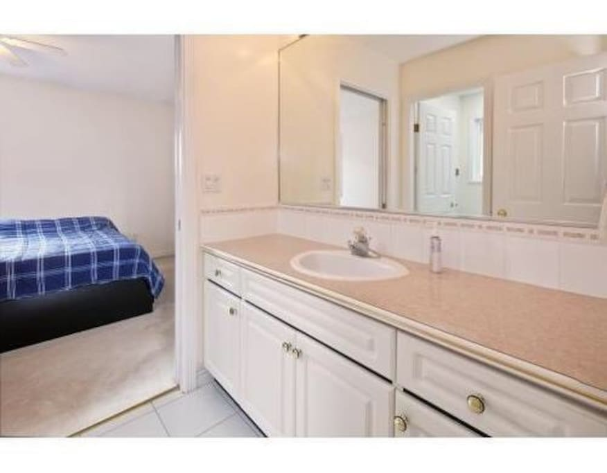 shared bathroom - sink separated from toilet/shower for multi-use