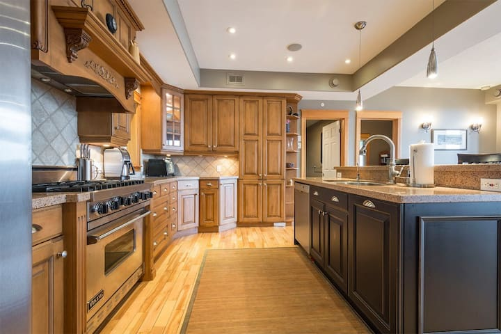 The kitchen is spacious and fully-featured.