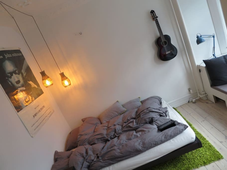 Japanese bed with futon mattress. Spanish guitar, cosy light and John Coltrane with his saxophone