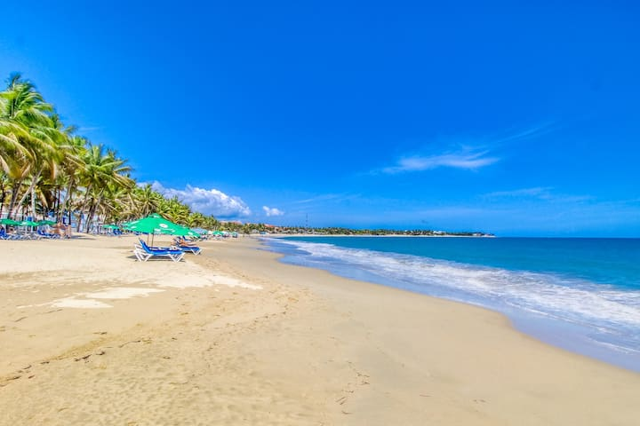Cabarete Bay oceanfront condo w/ beautiful floors & free WiFi right on the beach