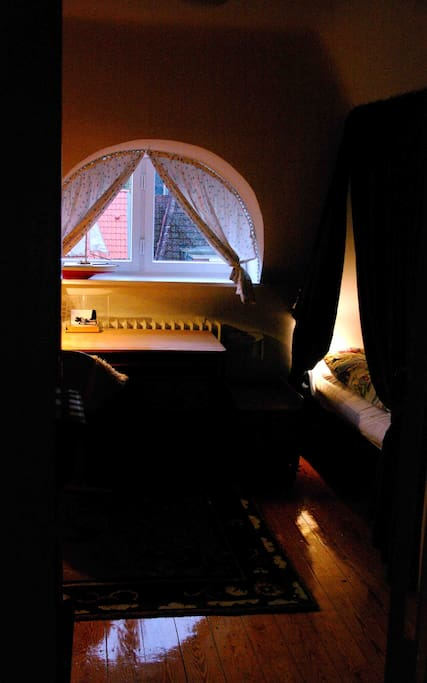 This cosy attic room welcomes you home after a busy day.