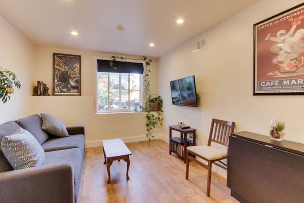 Living Room -comfy couch. Window to backyard. Smart TV with DVD.