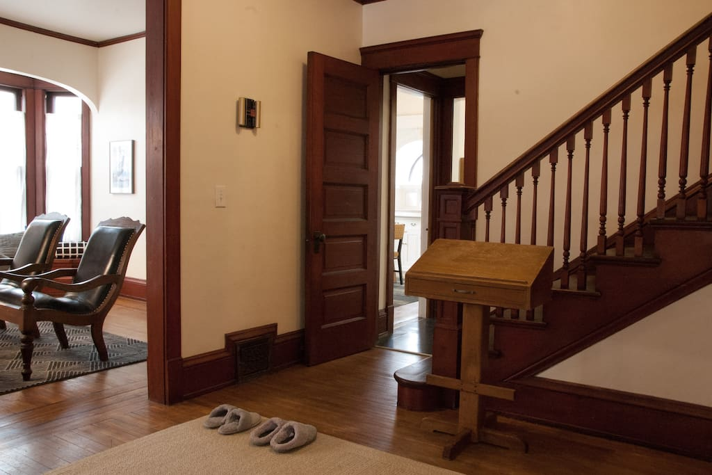 Entry foyer with original woodwork and guest slippers