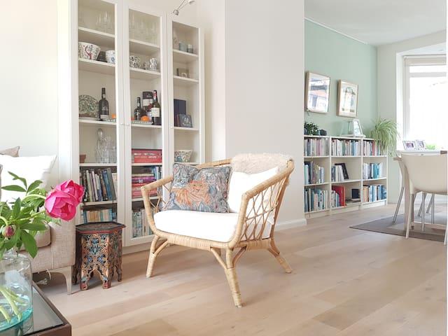 Light filled living room with tv (Netflix)