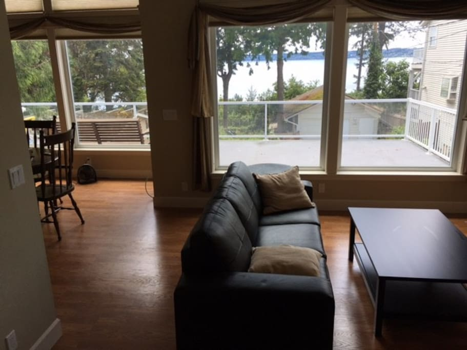 Comfortable living and dining room with Puget Sound view.