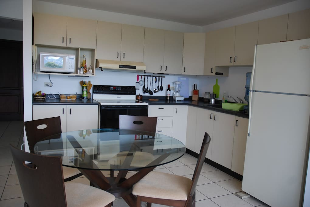 The kitchen is modern and all furnished.