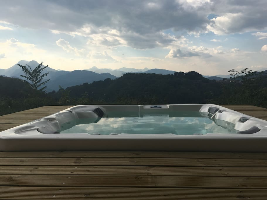 Hydro-massage tub with that stunning view - available to guests at Our Place in Tuscany.
