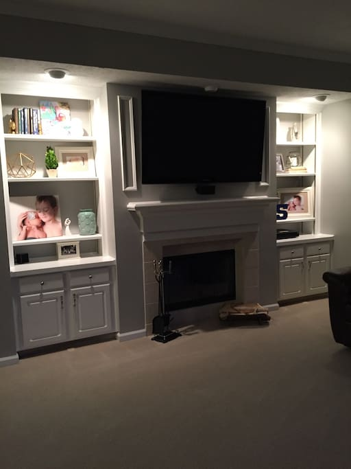 Custom built ins with large flat screen tv and surround sound