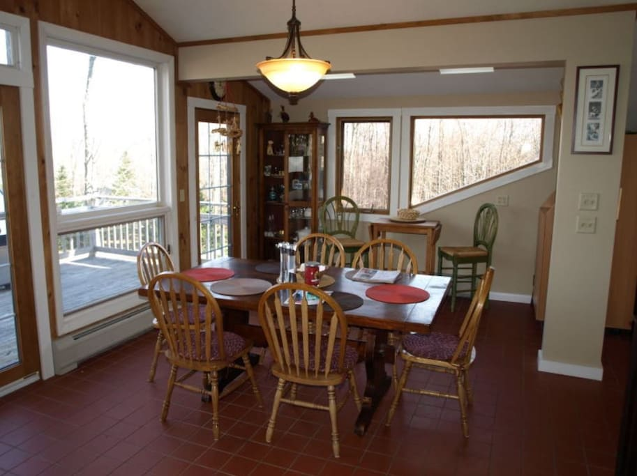 Dining Table overlooking deck with grill