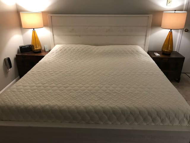 King sized bed with Leesa mattress by West Elm and Mannion Solid Wood Bed Frame in Shabby White by Birch Lane sold by Wayfair.