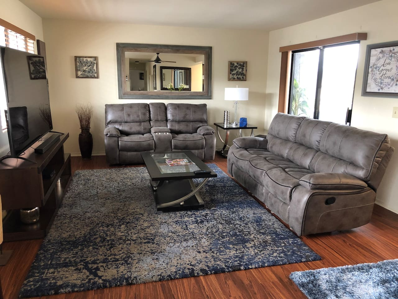 Living room with 75in 4k tv with Cable, HBO and Showtime and Theatre seating
