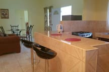 the kitchen in between the dining and living area