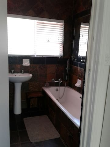 Bathroom nr 2 with bath and shower