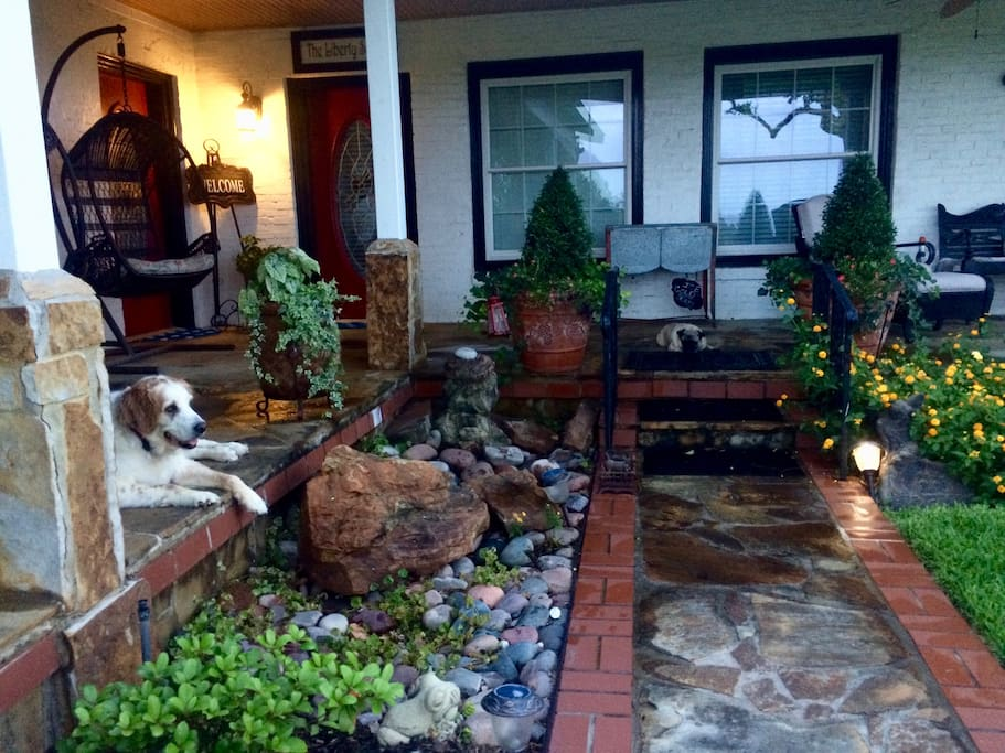 Mr. Pibb (pug) and SandiJo ( Large Mix Breed ) relaxing on the east porch.