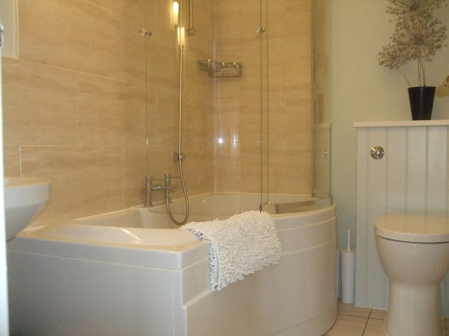 Newly refurbished the bathroom is warm and modern with heated towel rail and towels provided.
